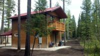 Lofted cabins are located in a wooded setting with forest views.