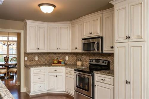 Custom cabinets and stainless steel appliances in every home.
