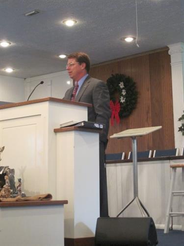 Jim preaching at a local Baptist church