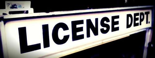 Our vintage License Dept. sign - proudly hanging out front of the agency