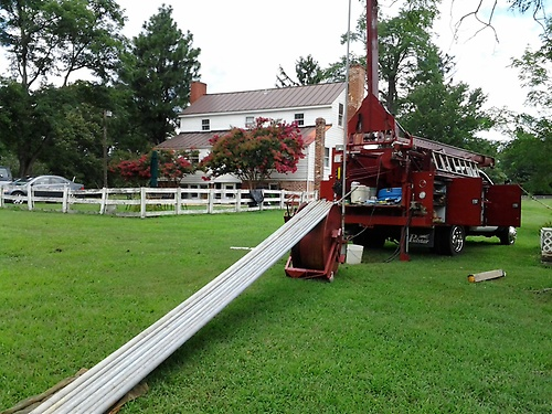 Gallery Image Matthews%20Well%20and%20Pump%20truck%20on%20the%20job%20with%20galvanized%20pipe%20by%20truck..jpg