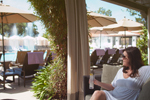 Relaxing poolside in a cabana at Herb Garden Pool