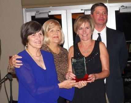 Maggie Siegfried and Janet Marshall accept the Non-Profit of the Year award for Chapin's We Care Center.