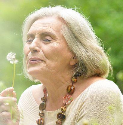 older%20woman%20blowing%20puff%20flower.JPG