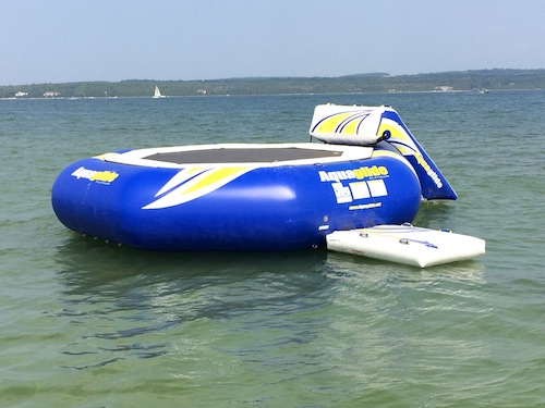 Water trampoline with slide rentals