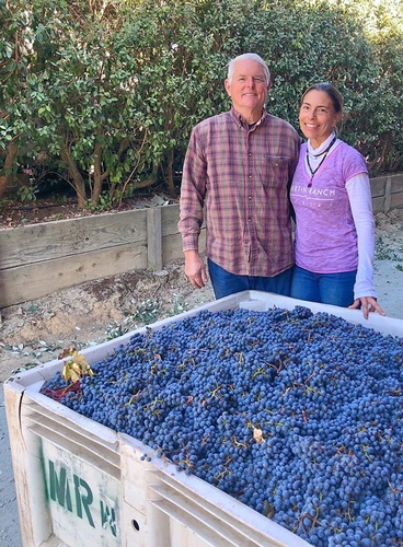 Gallery Image Martin%20Ranch%20owners%20and%20grape%20bin.jpg