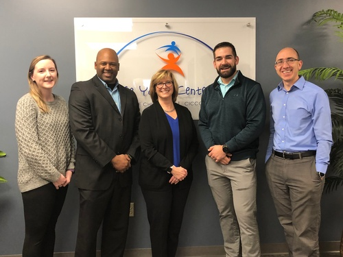 Colonie Youth Center (CYC) Executive Director Nikki Caruso, pictured with the ADNET team at the grand opening of CYCâ??s new facility in December 2018