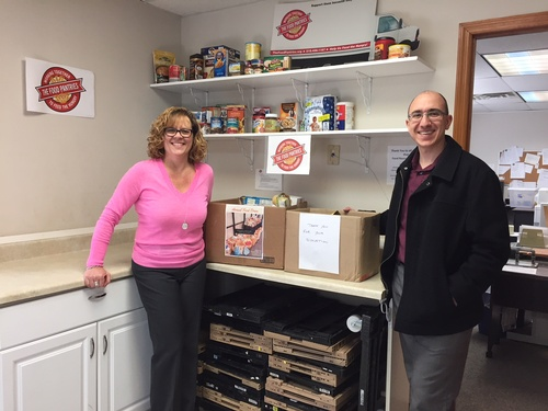 Nick Marchese of ADNET Technologies with donations from ADNETâ??s annual Food Drive, benefiting The Food Pantries for The Capital District