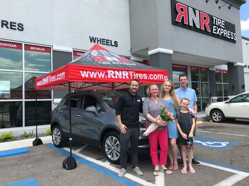 Family outside of RNR Tire Express location