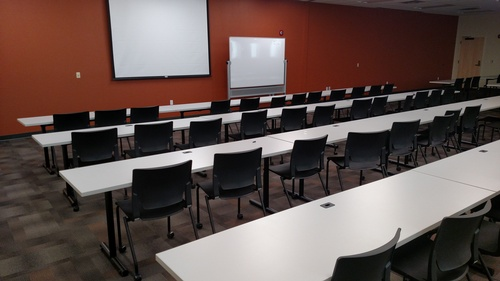 One of five training rooms with projectors and drop-down screens