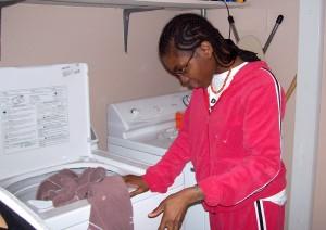 Gallery Image Resident-doing-laundry-300x212.jpg
