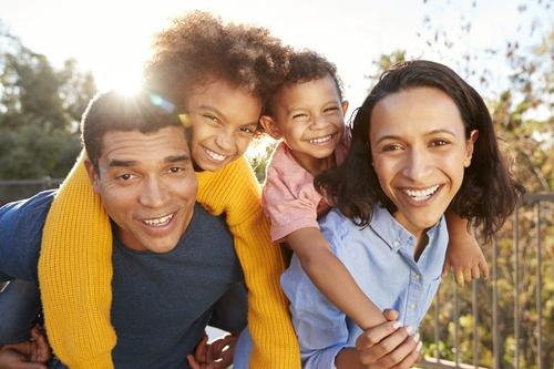 Gallery Image young-mixed-race-parents-parents-having-fun-piggyb-6HWX8CZ-scaled.jpg