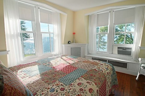 3rd floor bedroom named The Sunset room.. enjoy sunsets from the clawfoot tub.