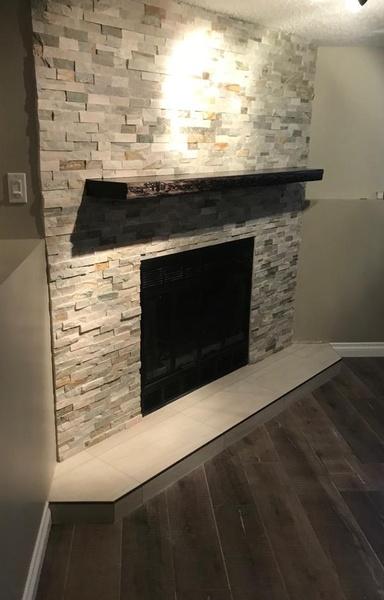 Laminate: Fuzion Flooring Laminate SoHo Loft - Evening Haze.  Fireplace: Shiner Casa Roma tile Ledger Stone - Beach Walk