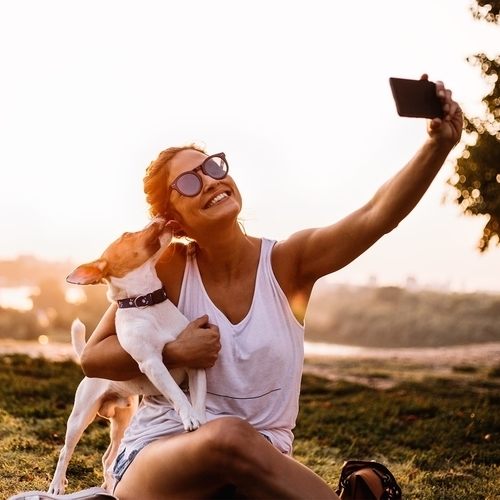 Gallery Image woman-with-dog-taking-pic.jpg