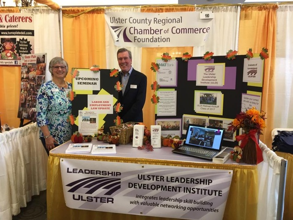 Ingrid Kulick and John Eickman running the Foundation's Booth at the 2016 Business Expo