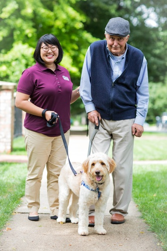 Gallery Image CAREGiver%20and%20senior%20male%20walking%20dog%202.jpg%20High%20Resolution.jpg