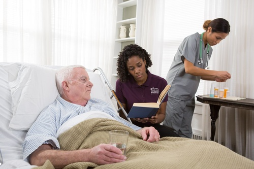 Gallery Image CAREGiver%20reading%20medical%20professional_hospice_3.jpg