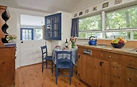 Prepare snacks and meals in the well-equiped kitchenette with dining table