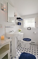 Newly renovated bathroom with a separate shower and skylight