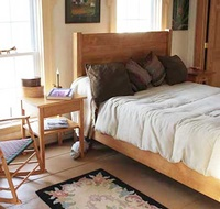 Red Oak queen custom bed designed by our customer to fit perfectly into her bedroom.