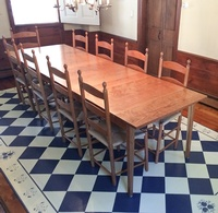 Cherry extension table with cherry Canterbury chairs with fibre rush seats for Conneticut customer.