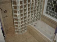 Glass block is a fantastic shower wall -- and no door track to keep clean!