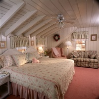 Port Fortune - King bed in a room with the look of your own private cottage
