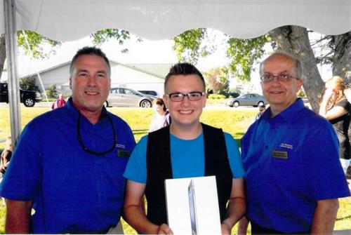 25th Anniversary IPad winner, Gus with Derril and Bruce