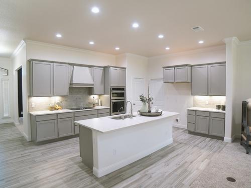 Pebble cabinets and quartz countertops