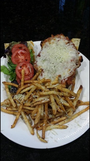 Gallery Image StingraysTaphouse_ChickenParmSandwich.jpg