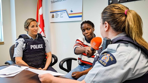 Crystal Kisakye interviews RCMP officers