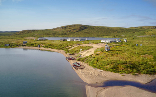 Gallery Image Peterson-s-Point-Lake-Lodge-Summer-Boats-on-Beach.png