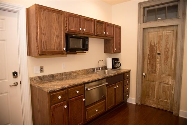 HCP Loft features kitchen with dishwasher, microwave, and convection cooktop.  Step into a warm shower and relish your privacy by peaking through Judge French's original peep hole on the bathroom door!