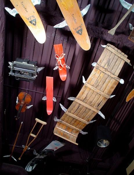 Gallery Image 2-skis-tobaggan-typewriter-violin-cue-crutch-and-snowb-1156x1500.jpg
