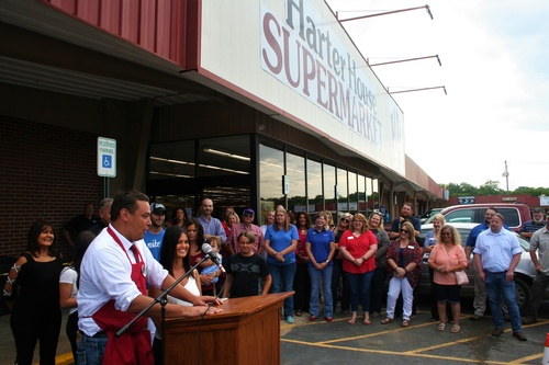 Owner Brad Bettlach addresses crowd during ribbon cutting at Harter House Supermarket in Berryville on July , 2019.