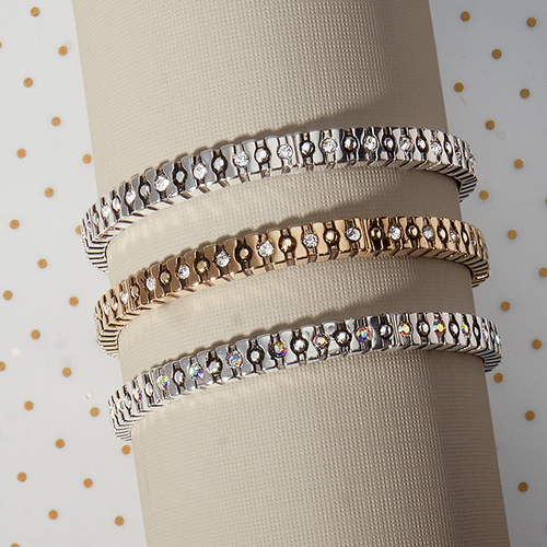 three mixed metal bracelets