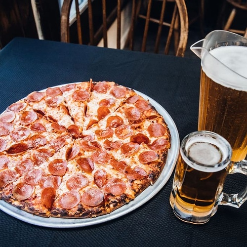 Who doesn't love a hot pepperoni pizza with a cold beer?