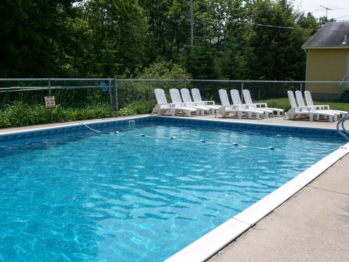 Deluxe motel rooms feature direct access to a private swimming pool and children's play area.