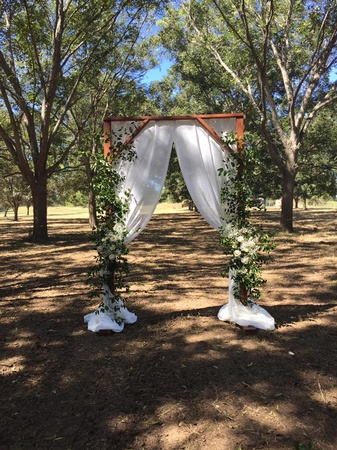 Arbor decorated with fabric and florals