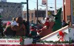 Santa Claus, the guest of honor in Kinston's annual Christmas parade, was escorted by a platoon of police cars to end the parade consisting of 99 enthusiastic and colorful participating units.