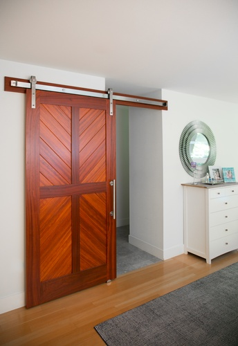 Padauk Four Panel sliding barn door and stainless steel classic flat track hardware