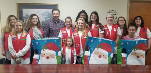 Thomas County Frontier Girls Troop 453 donated food and gift cards to Thomas County DFCS to help 4 families this Thanksgiving season.  Pictured with Troop 453 is Thomas County DFCS director, Ronn M. Ross