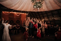 Gallery Image kansas_wedding_barn_bride_throwing_bouquet_fultonvalleyfarms-1.jpg