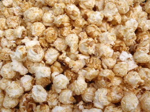 Gallery Image 7495350-Bunch-of-Kettle-Corn-Popcorn-in-a-pile-making-a-cool-pattern-Stock-Photo.jpg