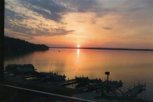 Spring Sunrise on Gull Lake. The boats are ready for a day of fishing for walleye, bass, northern pike, crappies, sunfish...what will you catch this morning?