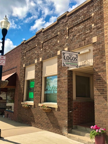 J&S Logos & Embroidery storefront at 219 W Main Street in Historic Downtown Pipestone
