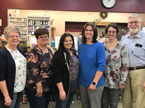 L to R:  Cherrie (Clerk), Connie (Clerk/Gift Buyer), Bobbi Renee (Pharmacy Tech), Nellie (PharmD), Sandra Norberg (Bookkeeper/Gift Buyer), Jay Norberg (Pharmacist & Owner)