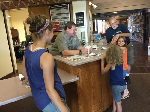 Kids Earning Junior Ranger Badge at Visitors Center - Photo by Erica Volkir