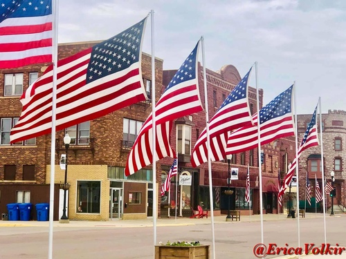 Avenue of Flags in Historic Downtown Pipestone - Photo by Erica Volkir
